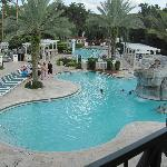 A view of both pools from the upstairs patio bar