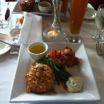 Huge crab cake and fried lobster tail with haricot verts - delicious!