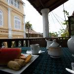 Breakfast begins with a plate of fresh fruit and pot of tea. Try the Sri Lankan breakfast