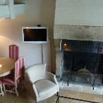 Premier niveau d'un triplex: salon et cheminée