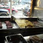 """Where the magic happens - the """"seasoned"""" grill smoldering & sweating onions, cooking dogs & burg"""
