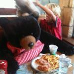 My son having dinner with two big black bears