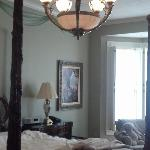 Chandelier above carved-post bed in Cortland Suite