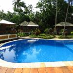 Swimming pool with pool-side cottages