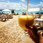 mango colado at the beachside bar