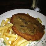 Schnitzel with mushroom sauce and chips