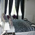 Double bedroom with en-suite, road side but quiet