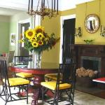 View of diningroom with fresh cut local sunflowers