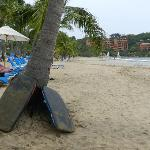 Wide beach with plenty of lounge chairs and hammocks