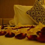 Bedroom with flower petals
