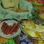 Homecooked breakfast of hotdogs, fresh farm eggs, homemade bread &instant noodles (all complimen
