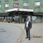 dr parmod in front of hotel