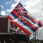 The Hawaii State flag waves gently in the Makawao upcountry cool breeze