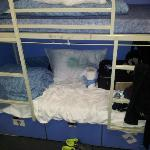 The bunks go three up, bottom bunk gets the smelly shoes, watch for it!