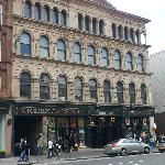 The theatre is on the top floor of this building in Argyle Street