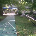 "shuffleboard, hammock and a ""DIY"" party/bar/BBQ area"