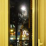 Looking out of balcony door with fireworks in the distance