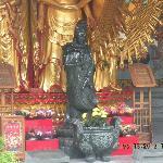 Buddhisattva of Compassion at Buddha's feet