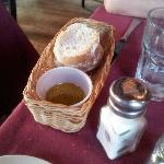 Fresh bread with Olive Oil in a plastic mini cup