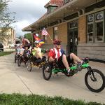 Cyclists on the Great Greenway Tour in front of the historic Wysor St. Depot.