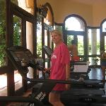 Pam walking the tread mill in the gym