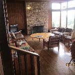 Activity room off reservation desk. Puzzles, games, fireplace, TV. Huge windows overlooking val