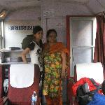 Inside the Shivalik Express, the toilet door is right behind the lady
