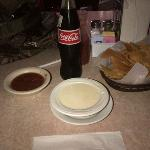 Mexican Coke, cheese dip, and delicious chips and salsa.