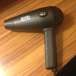 Fold up hair dryer with retractable cord