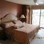 King size bed, wardrobe, and patio door