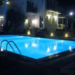 The pool and hotel at night
