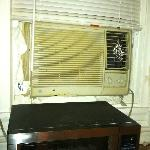 towels and card board in window around air conditioner