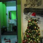 christmas tree next to entrance to male bathroom