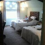 dudley suite with 2 double beds, en suite bathroom, flatscreen tv, dressing table, tea and coffe
