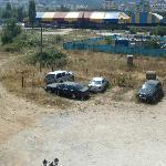 """The view of the """"secure parking facility"""" (dirt lot) and """"park"""" (landfill)"""