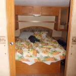 Queen bed in RV Rental Site 213