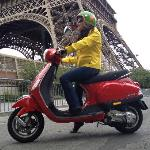 Red Vespa Liberty next to the Eiffel Tower