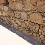 Original stone walls below the black lines