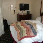 hotel room w/ tv on side wall