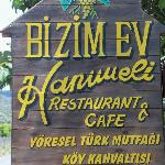 Sign in front of restaurant.