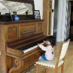 my daughter playing piano at Anne's home