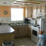 Very nice large kitchen with view of the Gulf of Mexico in the distance