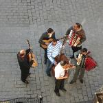 Musicians performing below our window