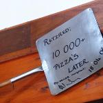 "This ""Pizza Shovel"" was displayed on the wall of the Swellendam Restaurant."