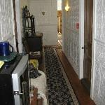 Hallway with coffee cart and deco sofa and cabinet.