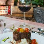 Grilled filet mignon with zinfandel demi-glace, roasted garlic and cherry tomato confit
