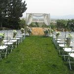 An intimate wedding setting overlooking the vineyard and Owyhee Mountains