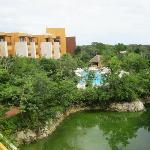 view from the lobby of one pool and one building of guest rooms