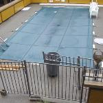 Pool With Garbage All Over It And Around It