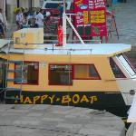 "one of the boats that docks at night ""Happy Boat"""